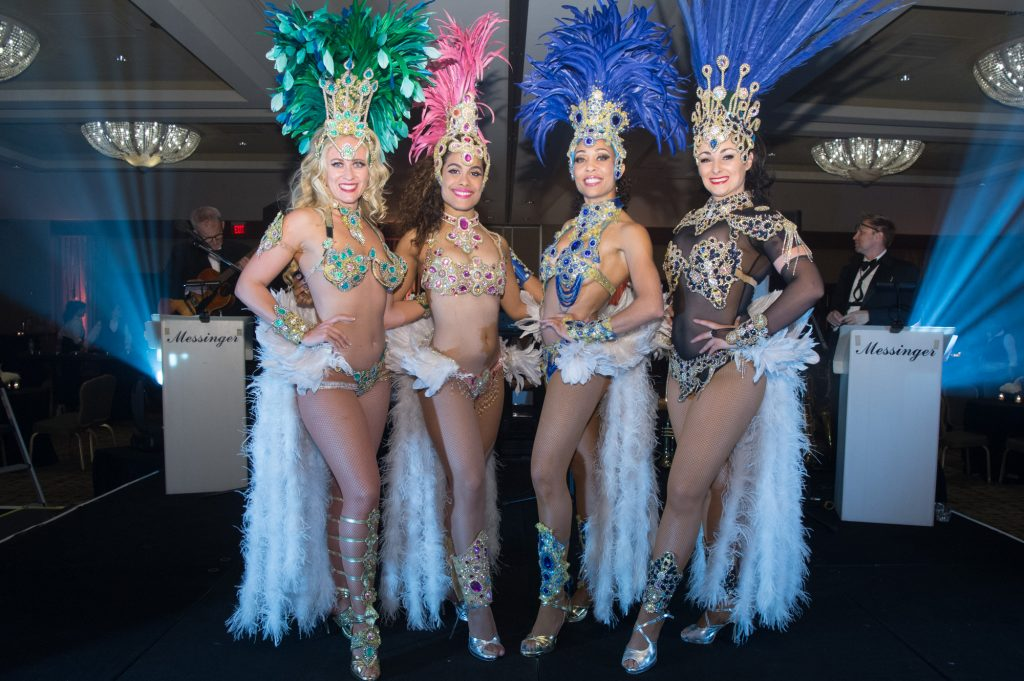 Vegas showgirls perform at a Vintage Vegas themed corporate event in Phoenix.
