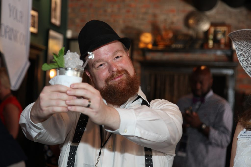 The $100 mint julep, all proceeds going to charity, enjoyed by a guest.