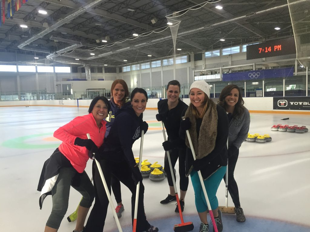 A sales team curling at the Olympic Stadium in Salt Lake City.