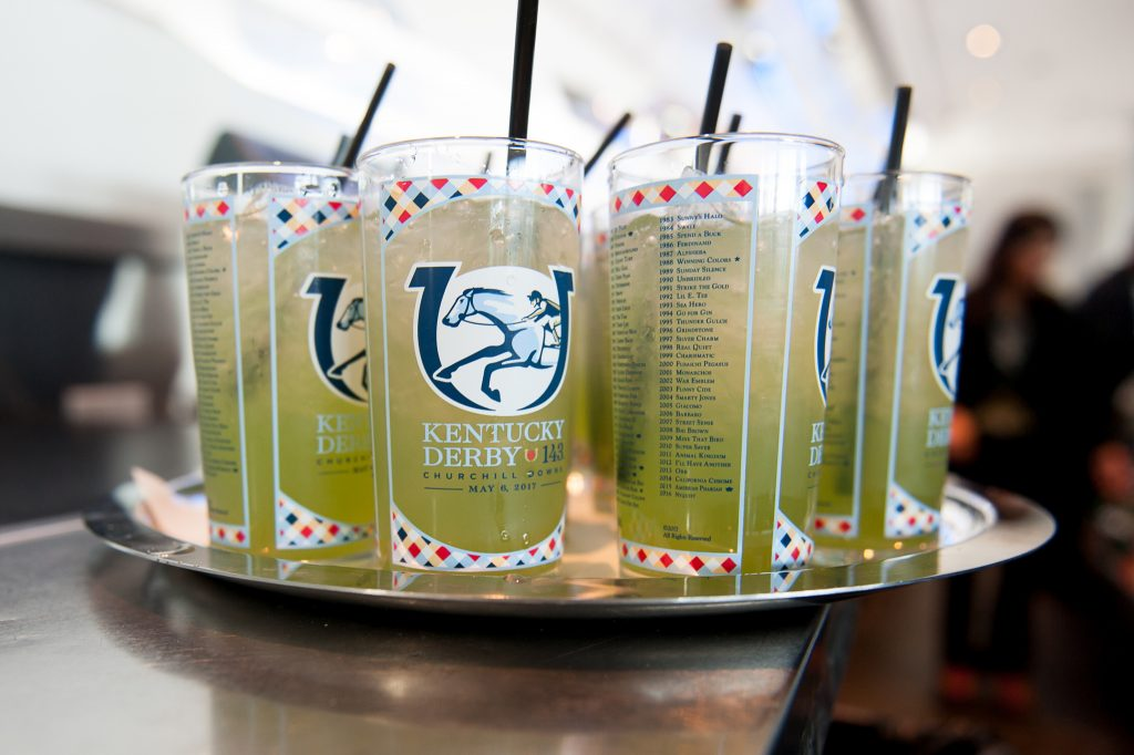 Classic Mint Juleps, with branded take-home glassware, are offered to guests at a Kentucky Derby-themed event for a group of surgeons.