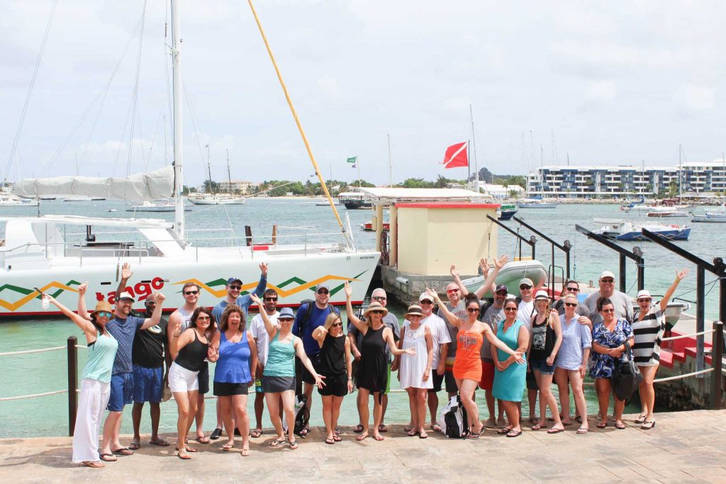 A group of top sales executives enjoy a catamaran sail on their incentive trip in tropical Saint Maarten.