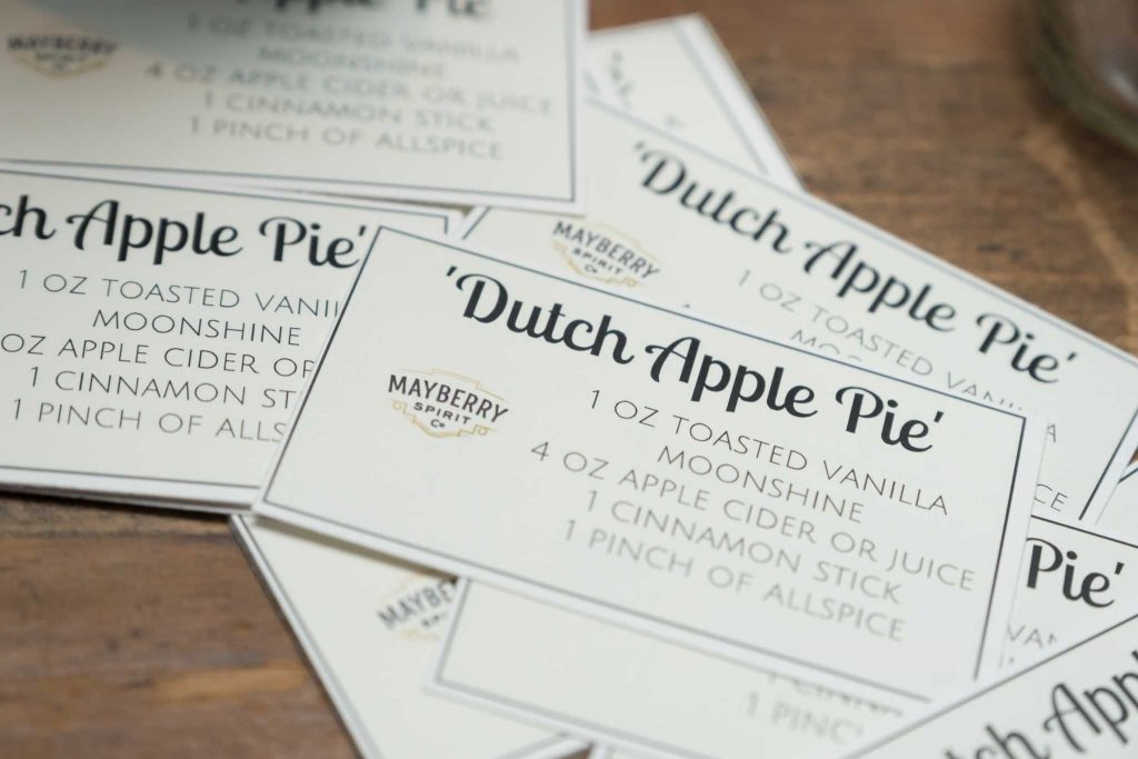 A Dutch Apple Moonshine recipe is shared with guests at a corporate cocktail reception.