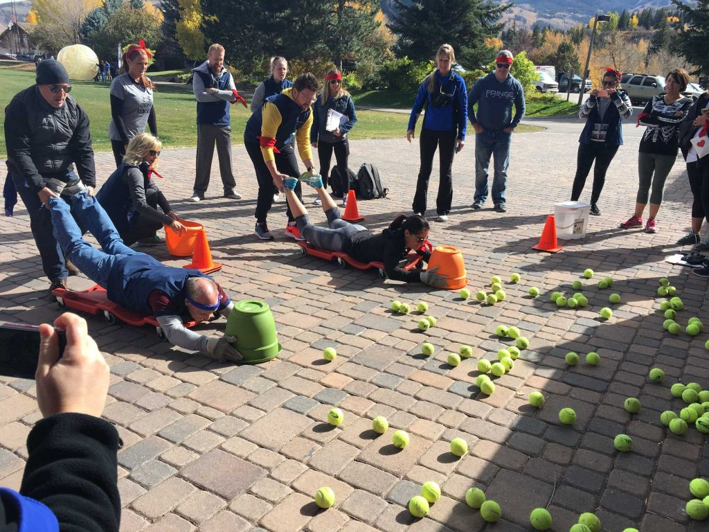 "Team building at its finest, playing the ""hungry hippo"" amidst the beautiful mountains of Beaver Creek, Colorado for an off site group activity during a week-long sales meeting."