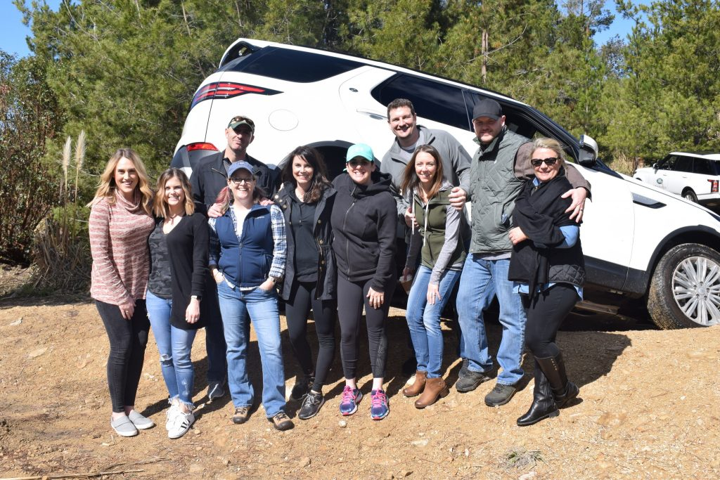 A group of top sales reps, along with their spouses, enjoy a fun Land Rover experience during an incentive trip to Carmel Valley.