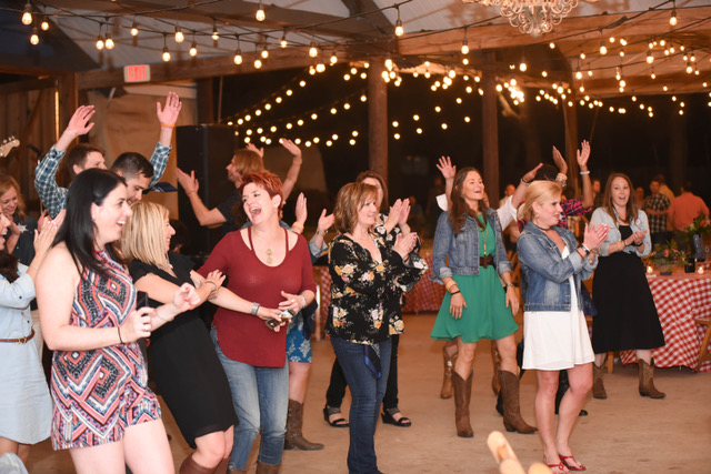 Line Dancing lessons for a corporate group outing at a ranch in Boerne Texas – yee haw!