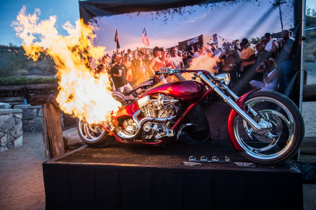 A custom chopper, complete with flame-blower, entertains a group of global partners during an evening event at a conference in Phoenix, Arizona.