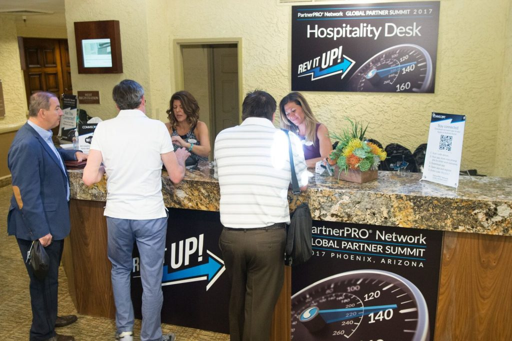 It's all about first impressions with a custom-branded registration desk.