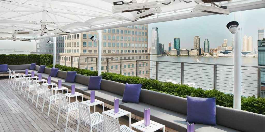 The rooftop of the Conrad Hotel in NYC is the perfect location for a corporate networking event.