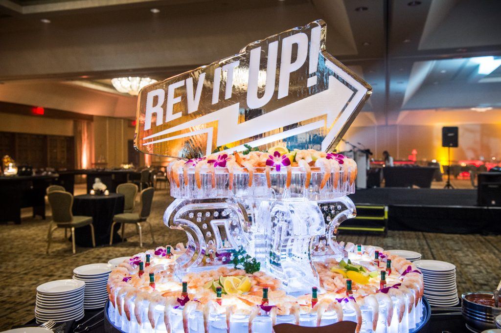Custom logo ice carved shrimp display at a Vintage Vegas themed evening is a great conversation piece!