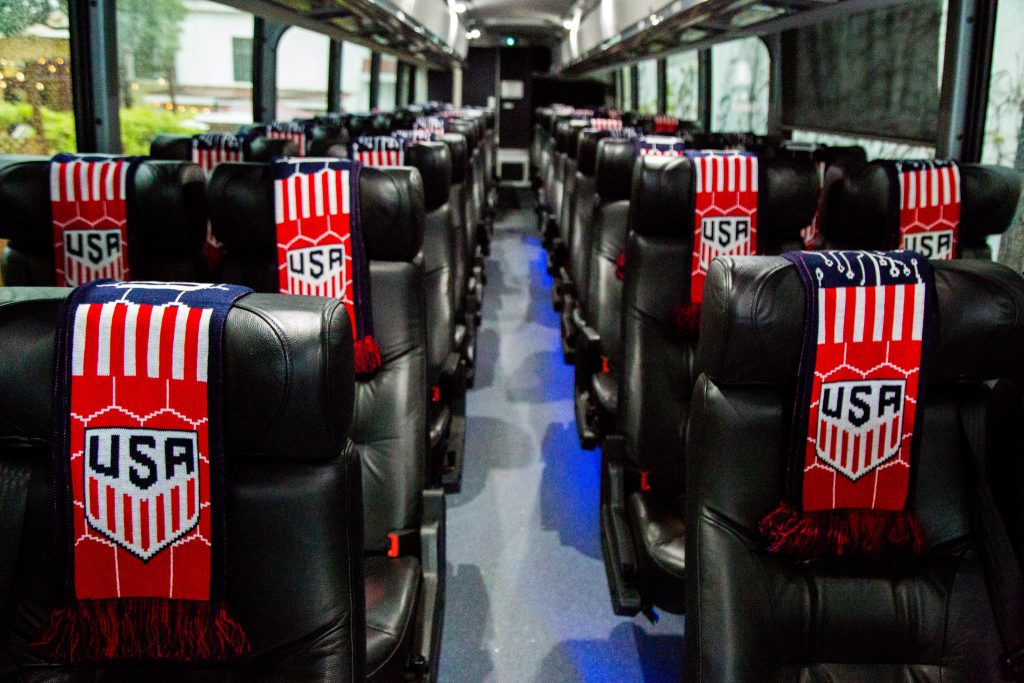 Luxury transportation with custom branded knit scarves to welcome guests and keep them warm at a major league sporting event.