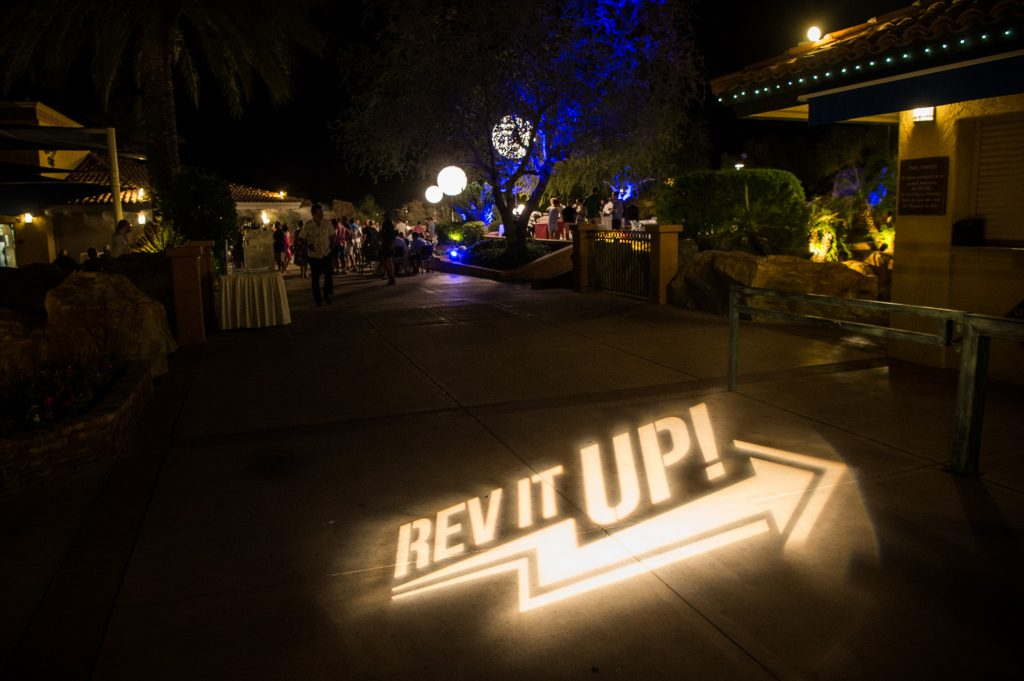 A custom branded gobo at a pool-side welcome reception for a Global Partner Summit in Arizona.