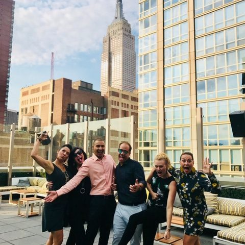 Taking A Group Shot With The Clients From The Rooftop In NYC