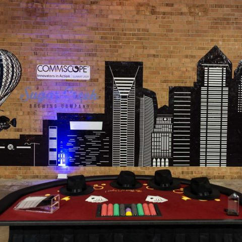 Brick Wall Of A Brewery Sharing Space With Branding For A Casino Night